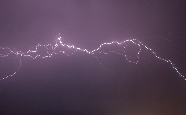 Red Lightning Flashing On Black Sky Free Stock Photo