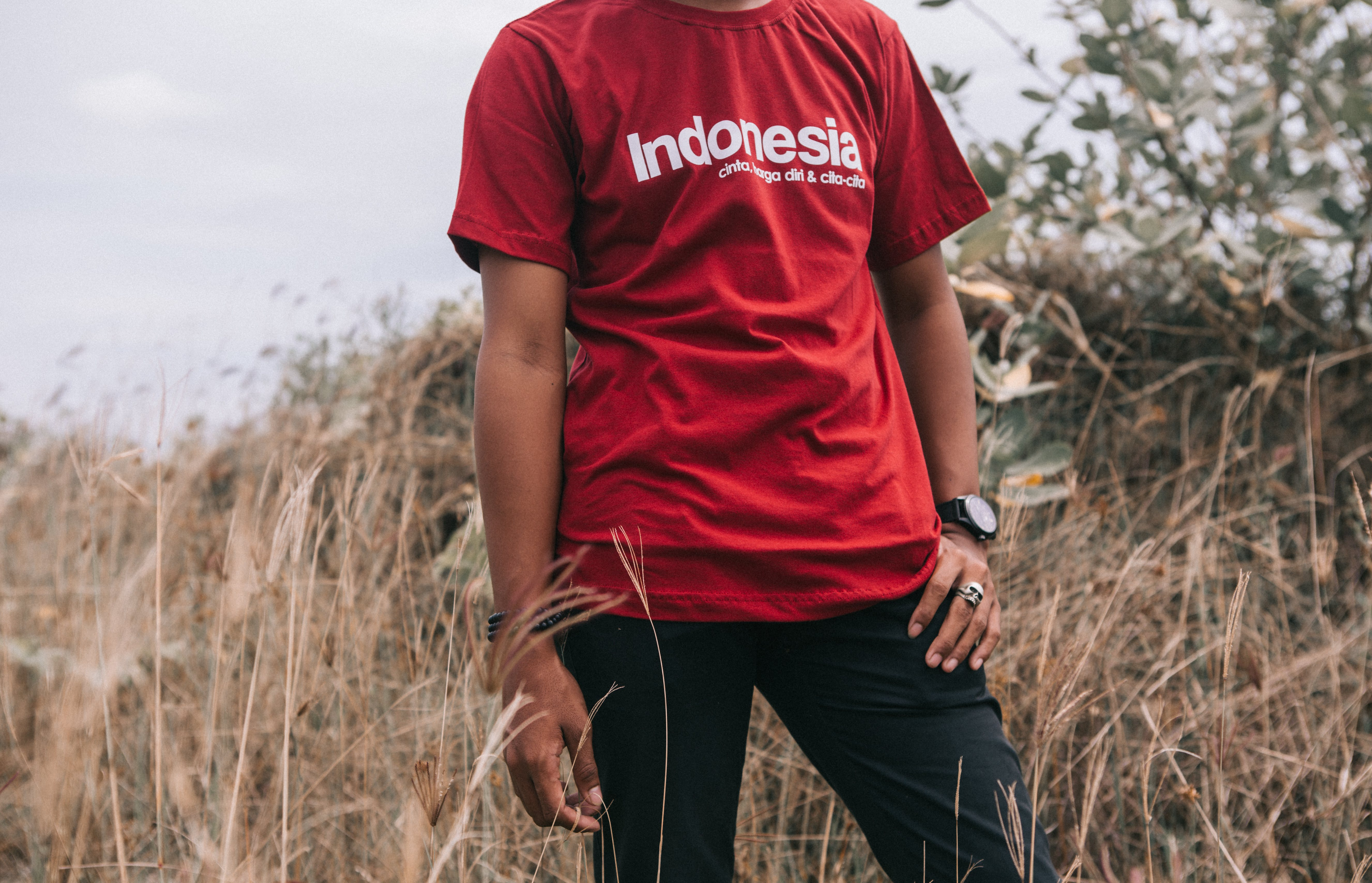 Man in Red Crew-neck T-shirt Beside Grasses