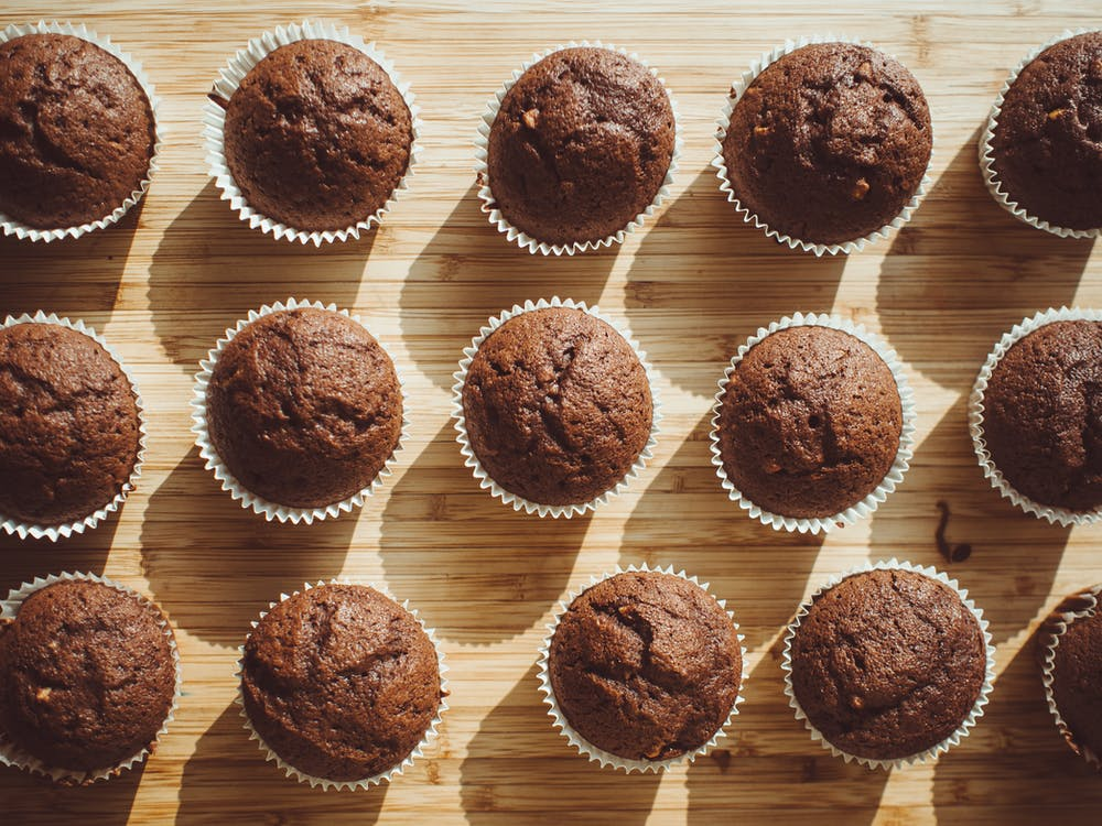Chocolate Cupcakes on Brown Wooden Board