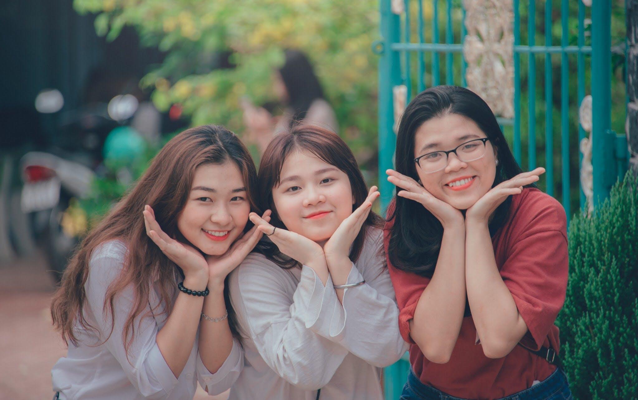 Three Girl's Wearing White and Red Dress Shirts