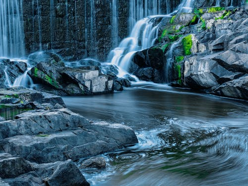 Water Falls on Rocky Shore