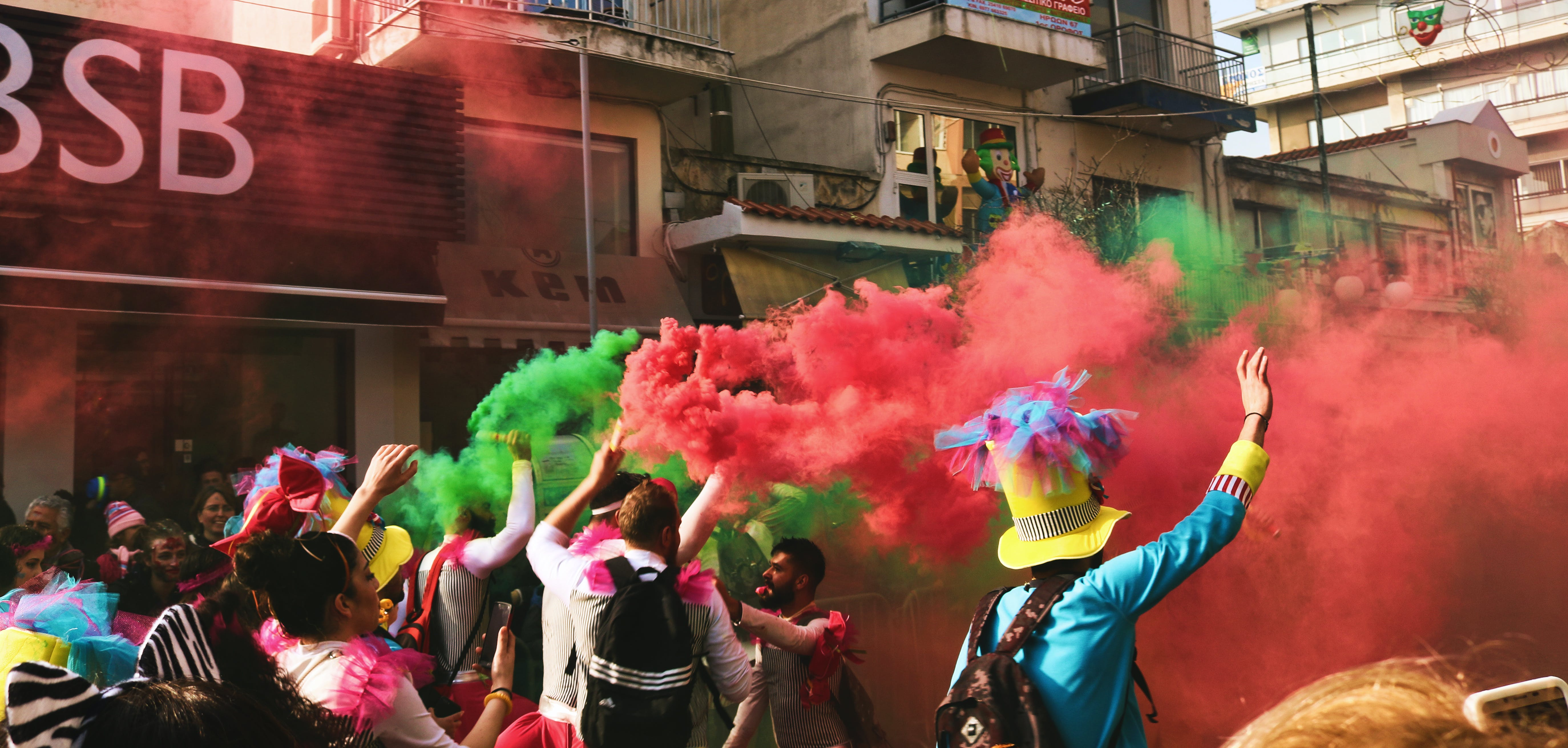 People Spraying Assorted Color Of Smoke