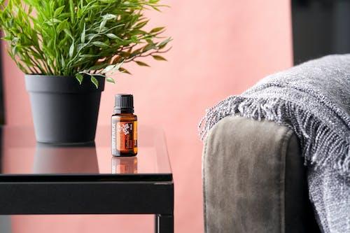 Black and Orange Labeled Bottle on Black Wooden Table