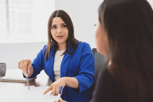 Woman Discussing Project with her Coworker