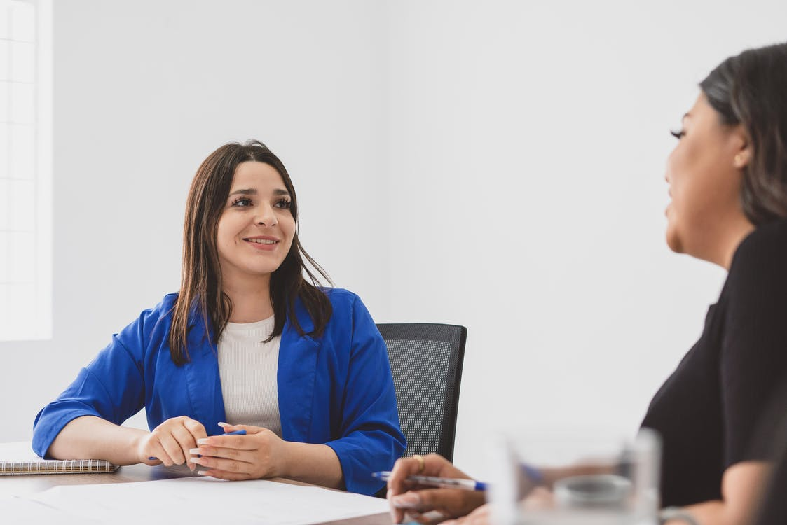 Woman Having a Conversation with her Colleague