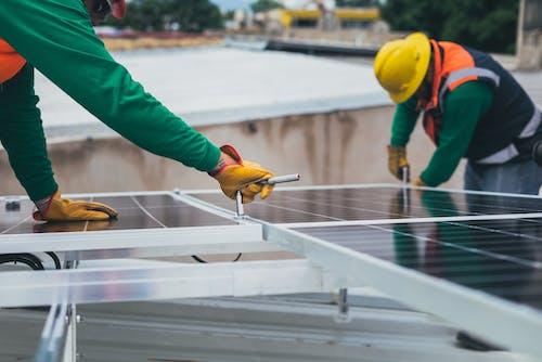 Fotos de stock gratuitas de casco de seguridad, electricistas, energía alternativa