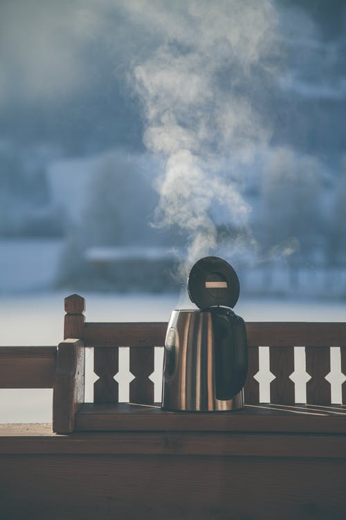 Gray and Black Electric Kettle on Wooden Bench