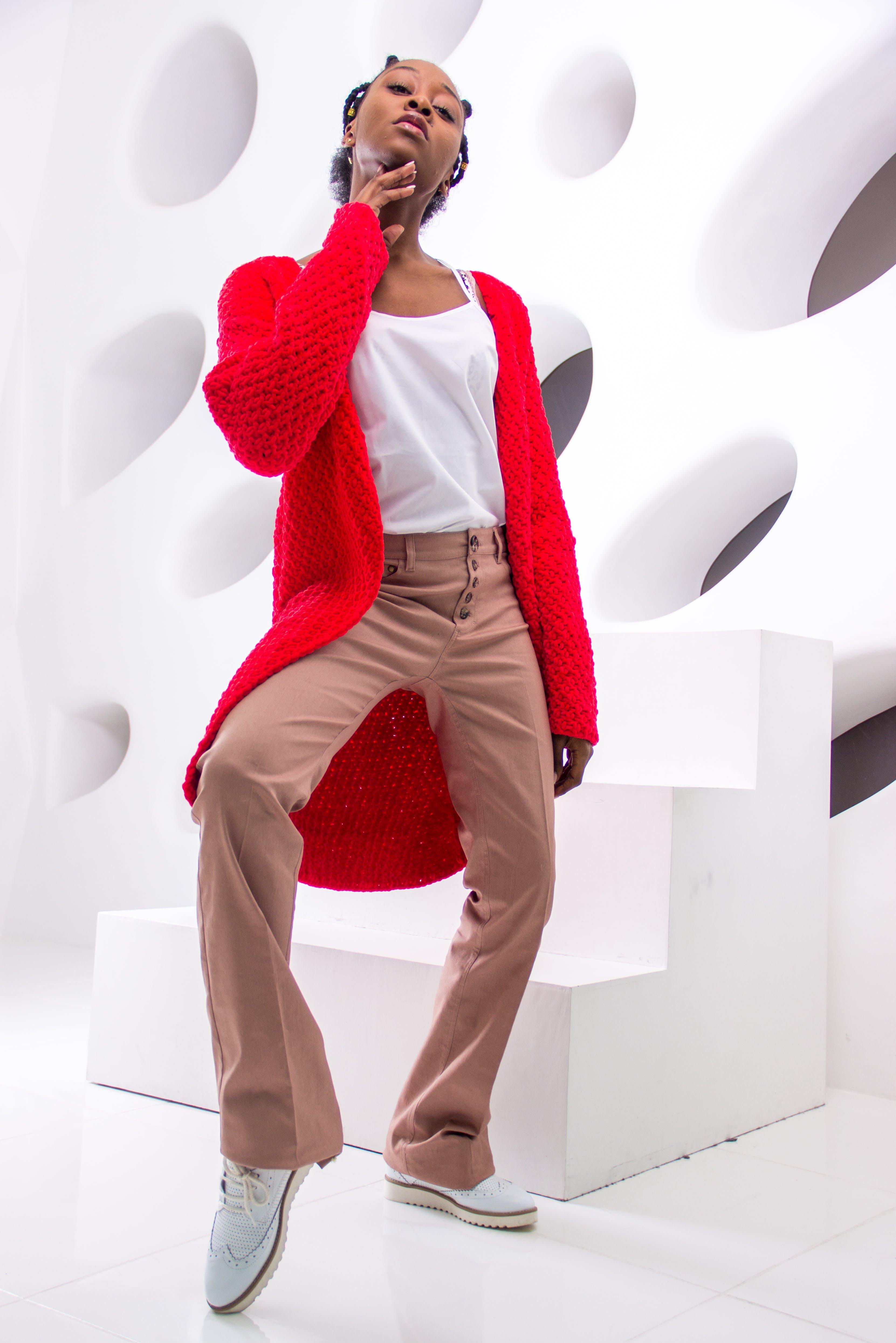 Woman Wearing Shirt, Red Cardigan, Beige Dress Pants