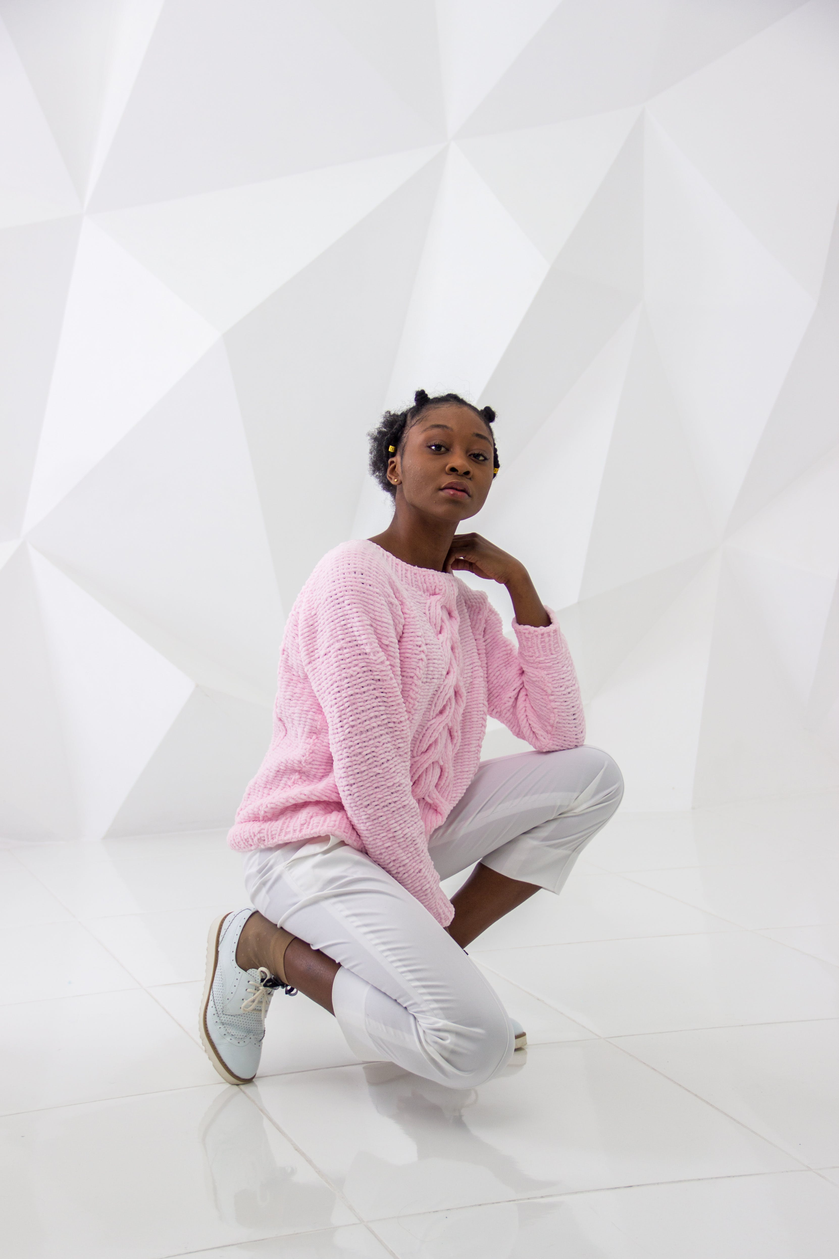 Woman Wearing Pink Sweater and White Pants Posing