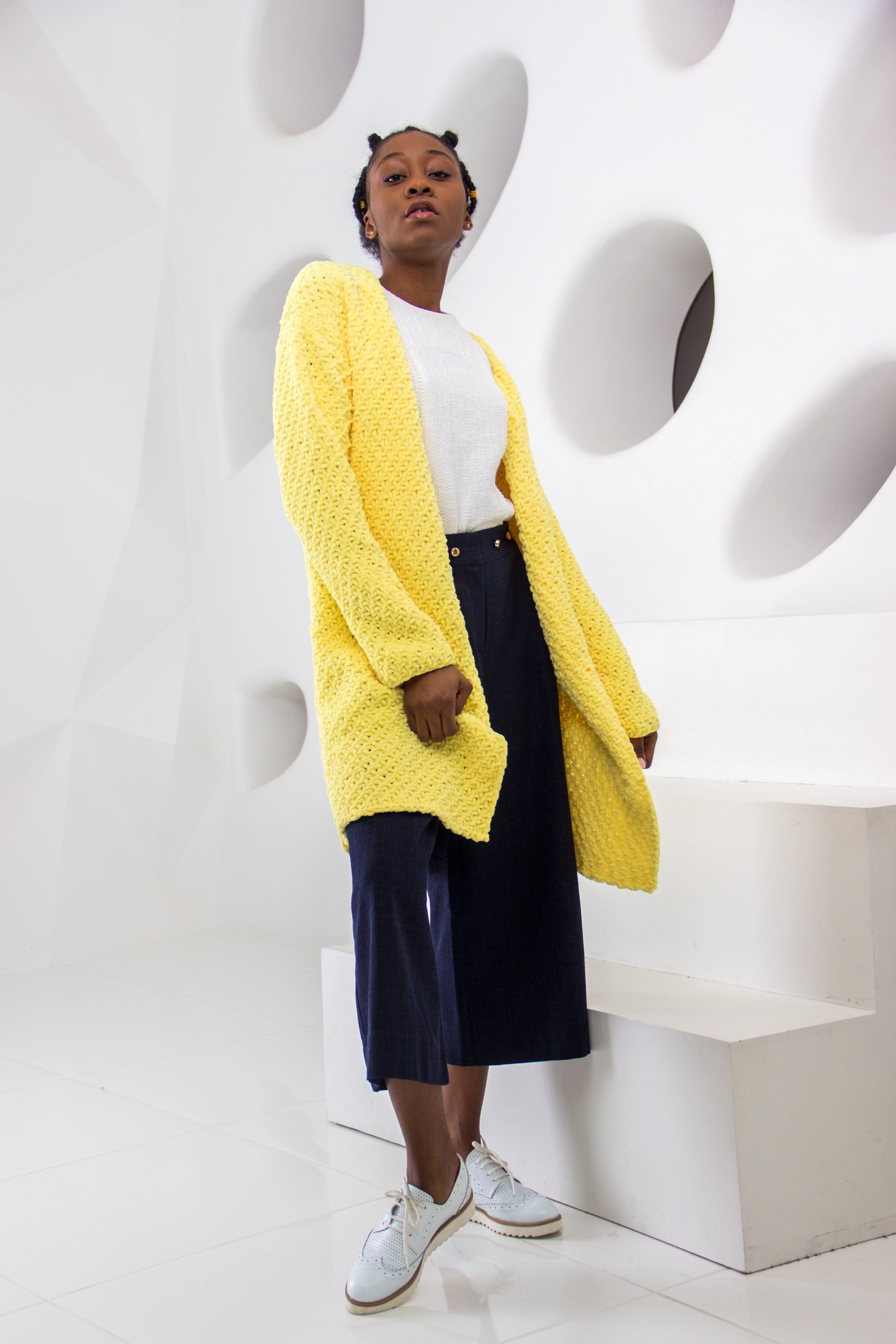 Woman Wearing Yellow Knit Cardigan Standing