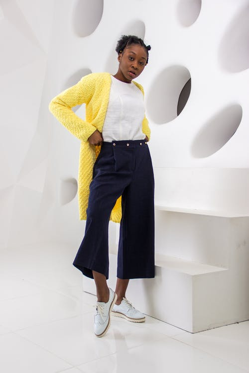 Woman With Yellow Cardigan and Black Pants