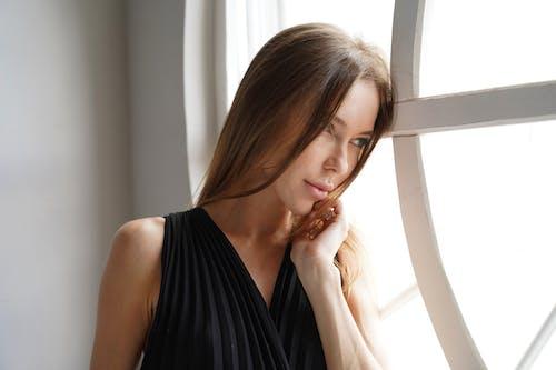 Woman in Looking on Window Pane