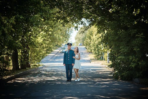 Couple Standing in the Middle of the Road