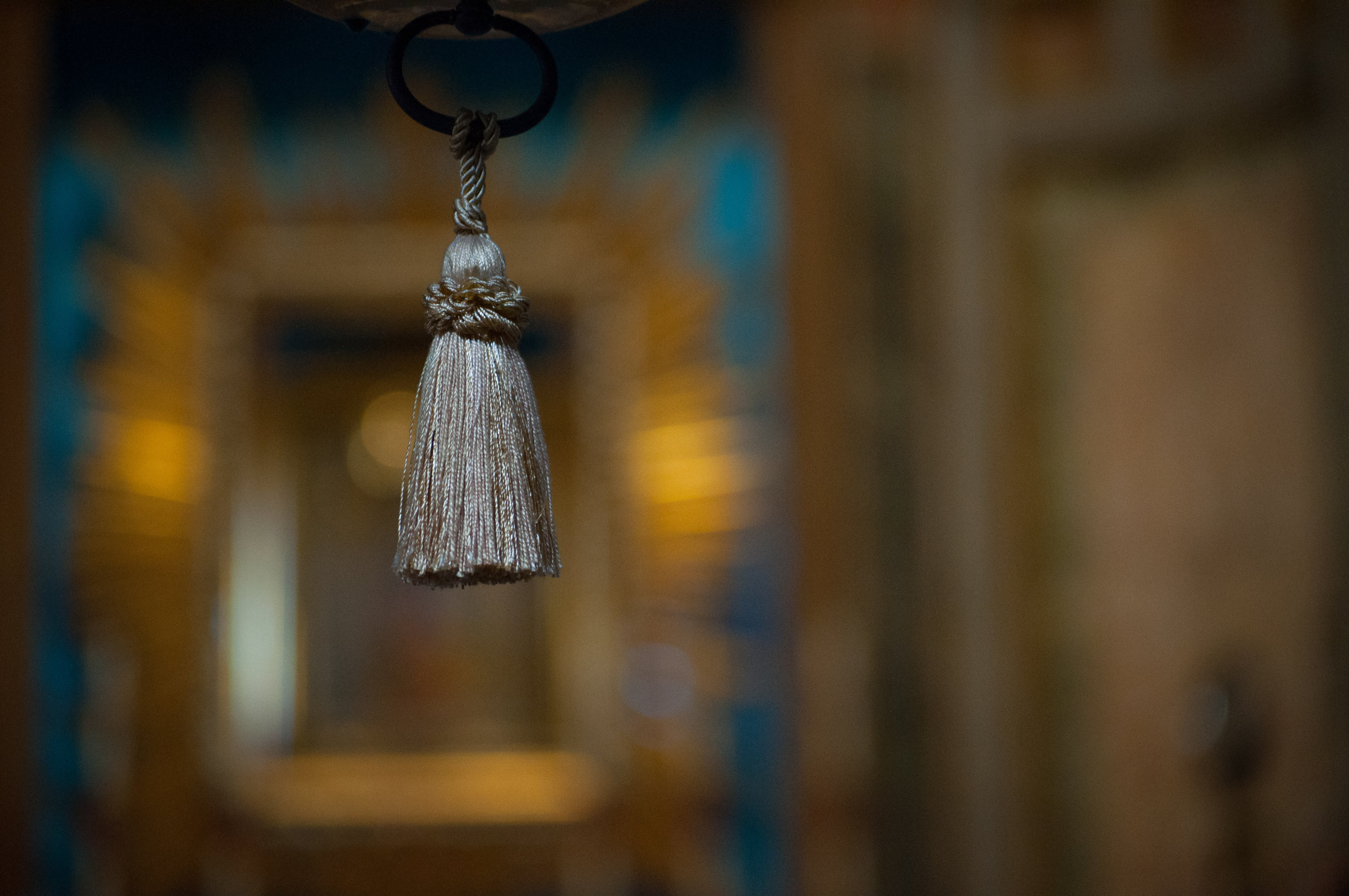 Selective Focus Photograph of Gray Tassel Accessory