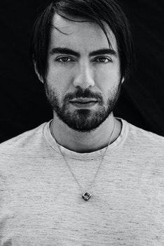 Grayscale Photo of Man Wearing Gray Crew-neck Shirt