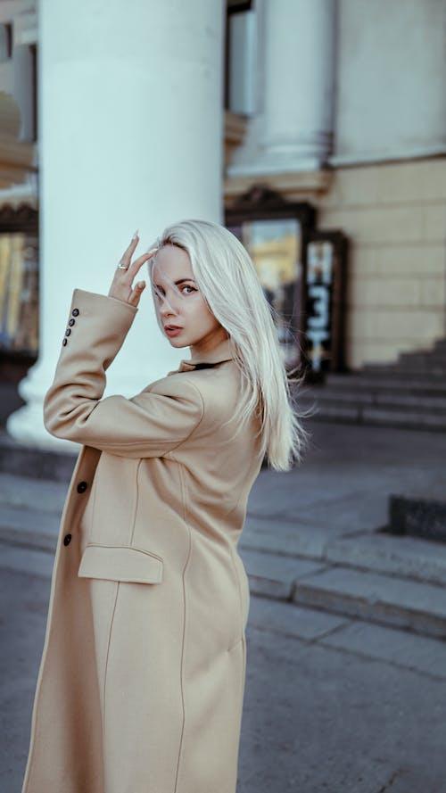 Woman in Brown Coat Posing at the Camera