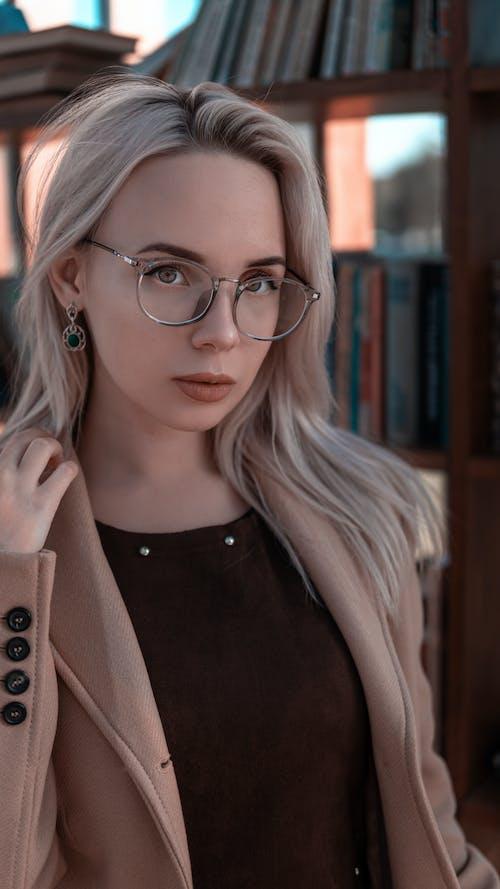 Woman in Brown Coat Wearing Eyeglasses