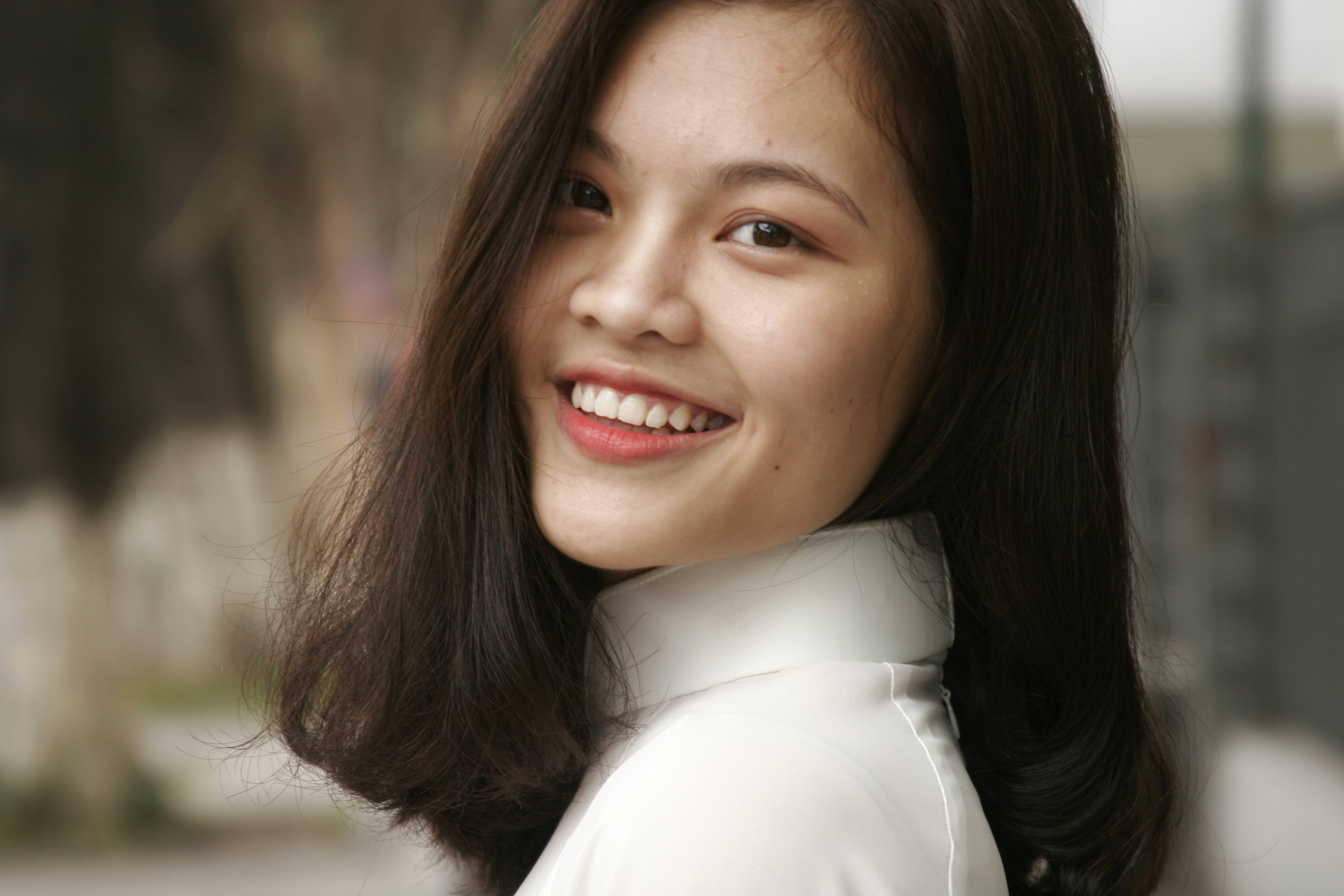 Smiling Woman Wearing White Turtleneck Top