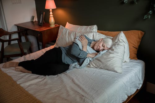 A Woman Laying on the Bed