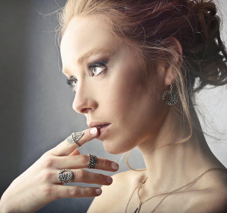 Woman Wearing Rings and Earrings