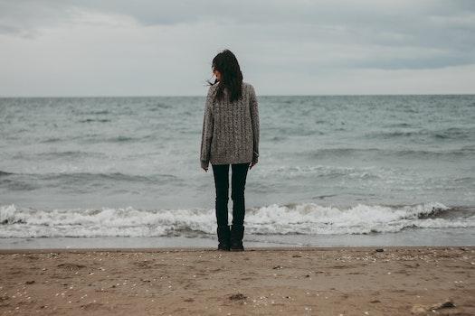 Free stock photo of sea, sand, woman, sweater