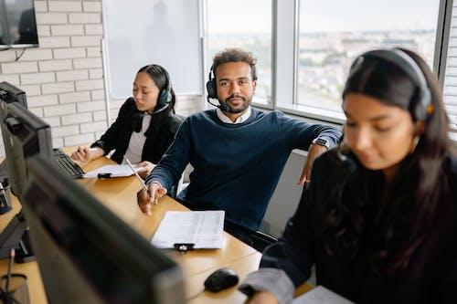 People Wearing Headphones in the Office