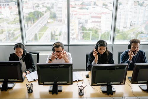 People Sitting in Front of Computers