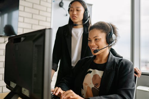 Two Women With Headsets Working As Call Center Agents