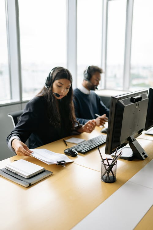 A Woman and Man Working in a Call Center