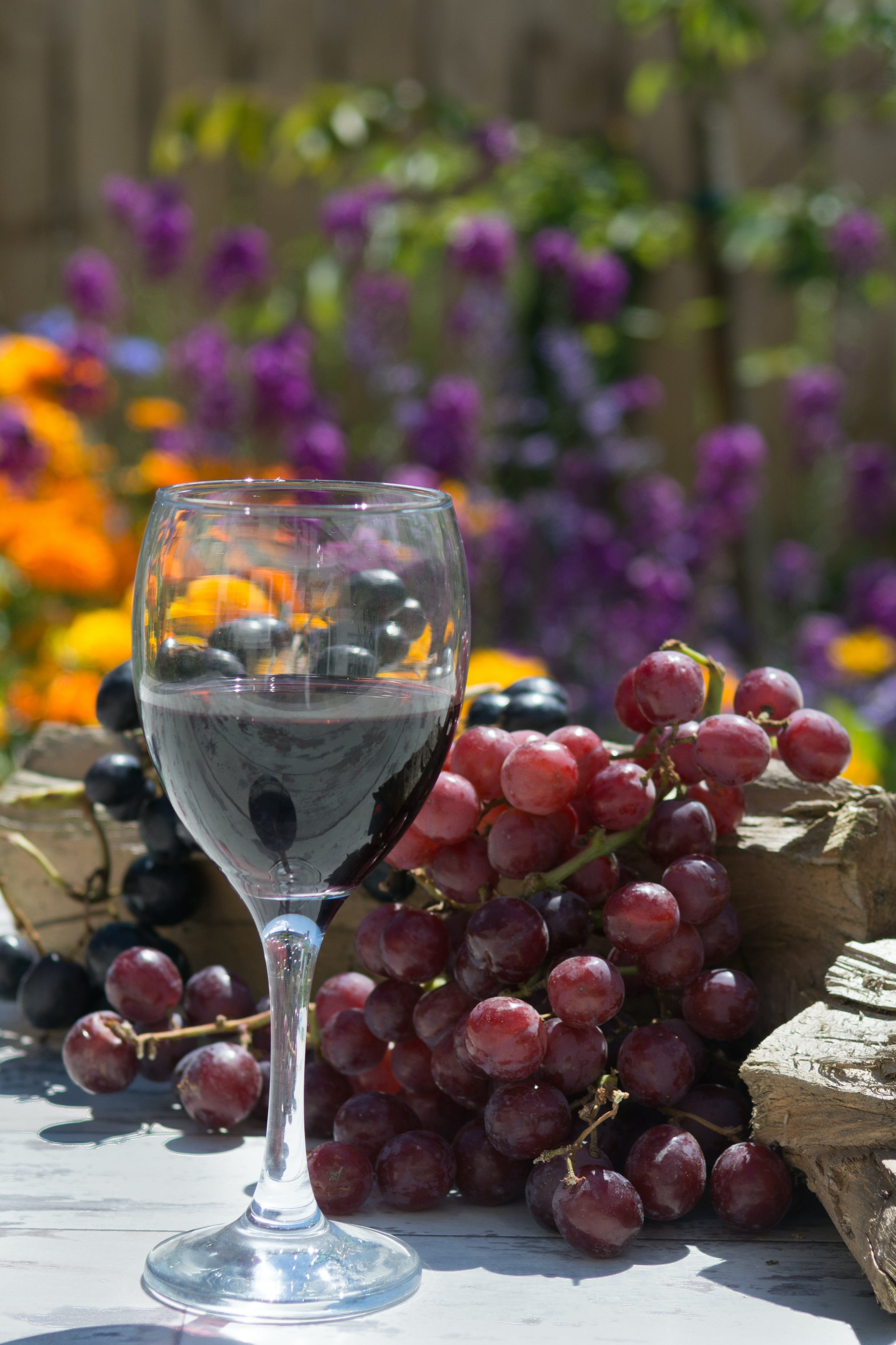 Clear Wine Glass Near Grape Fruit