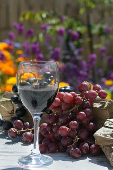 Clear Wine Glass Near Grape Fruit