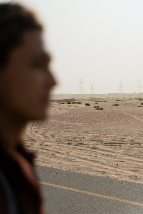 Woman in Black Shirt Standing on Beach
