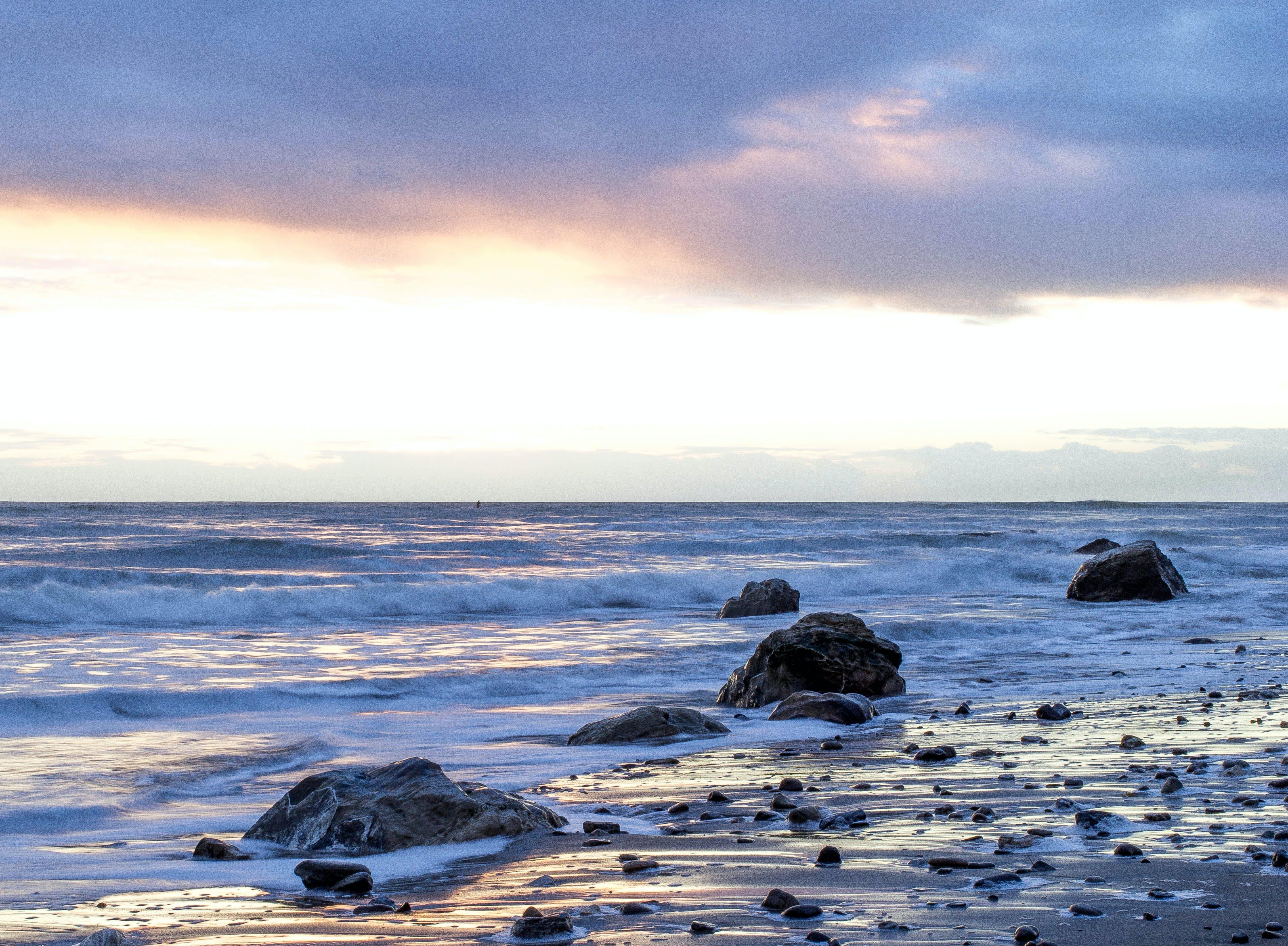 Sea Waves Splashing Through Rocks