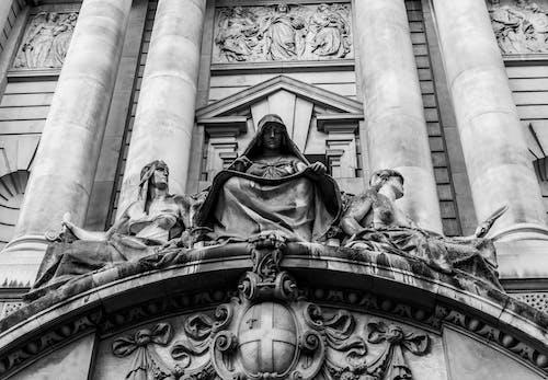 Black Statue of Man in Black Robe