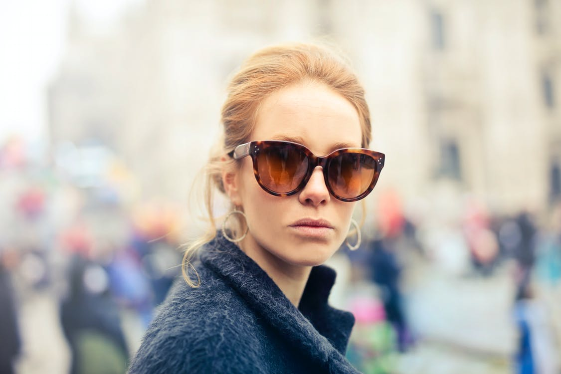 Woman Wearing Black-framed Sunglasses