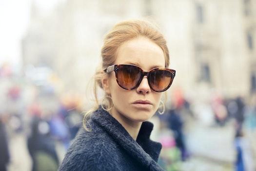 Woman Wearing Black-framed Sunglasses