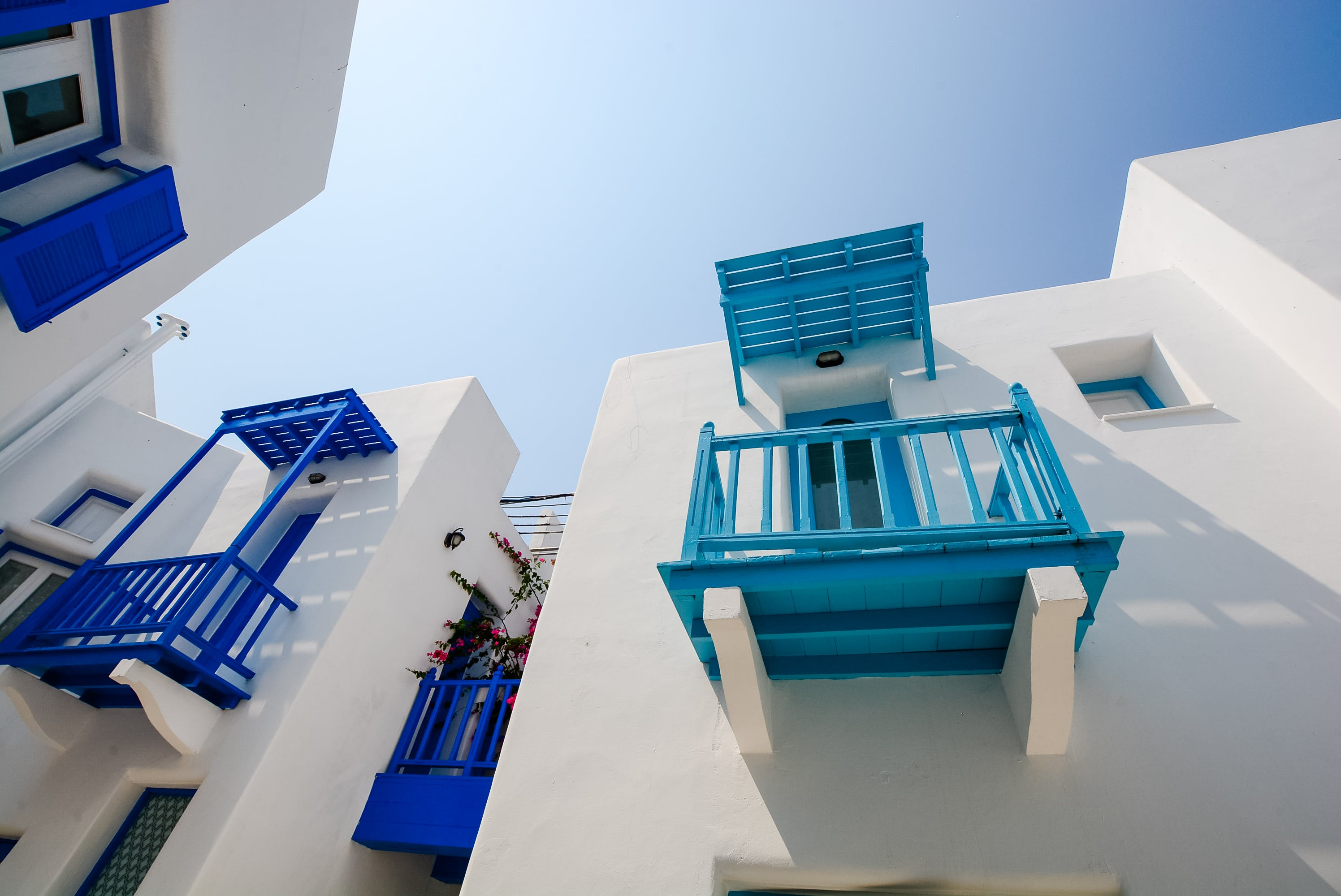 White Painted House With Blue and Teal Terrace