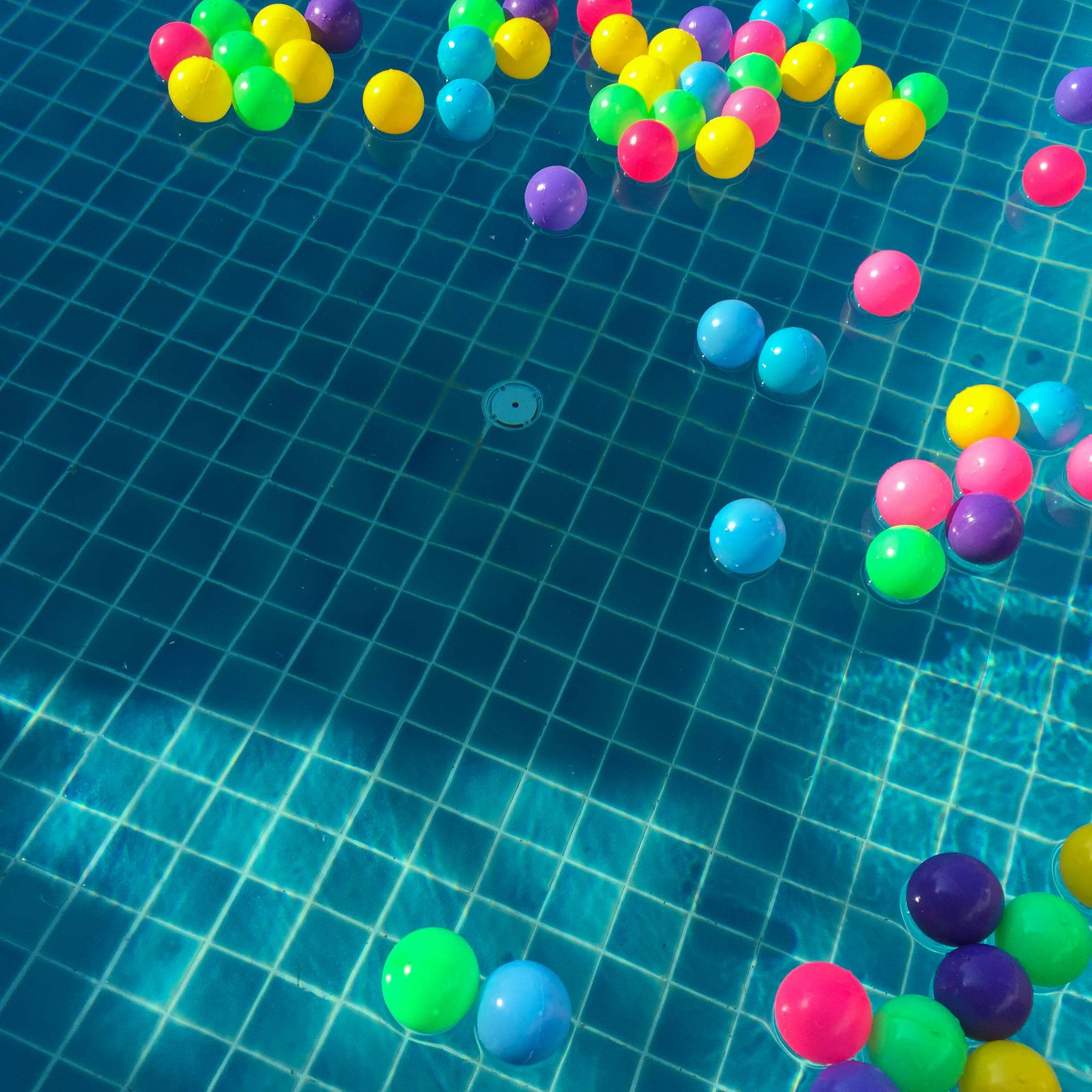 Assorted-color Balls Floating on Water