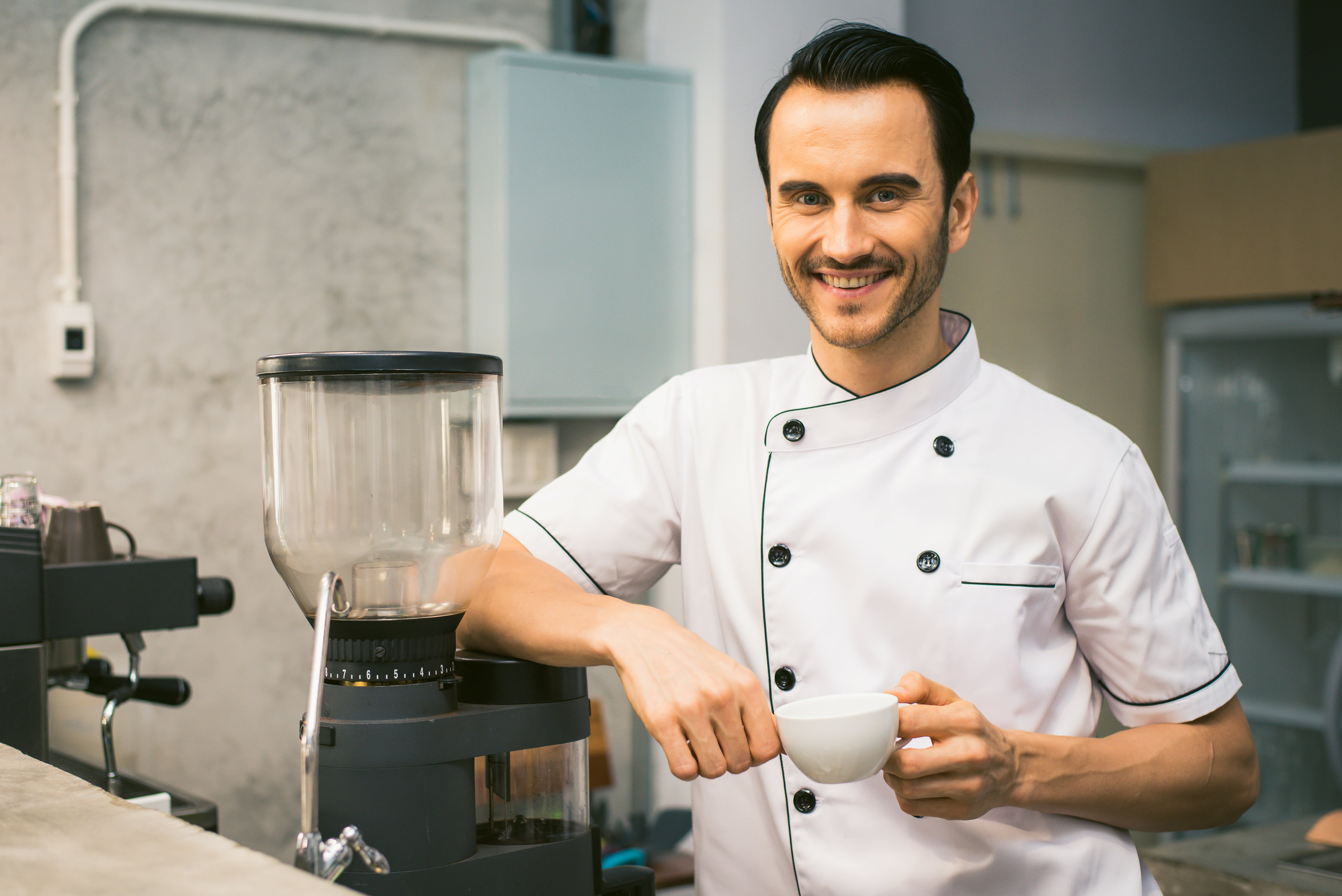 Chef Holding White Tea Cup