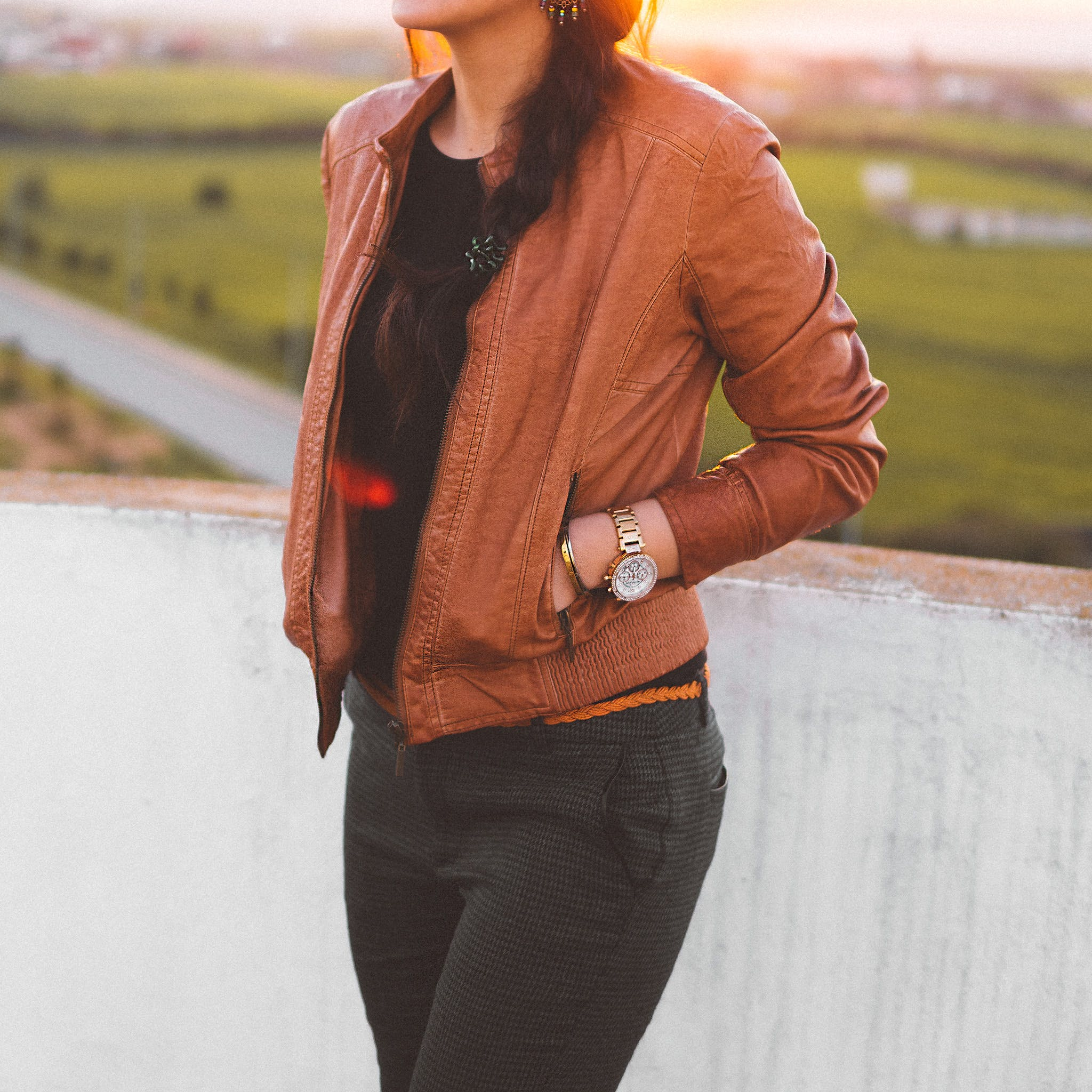 Woman Wearing Brown Leather Jacket and Black Pants