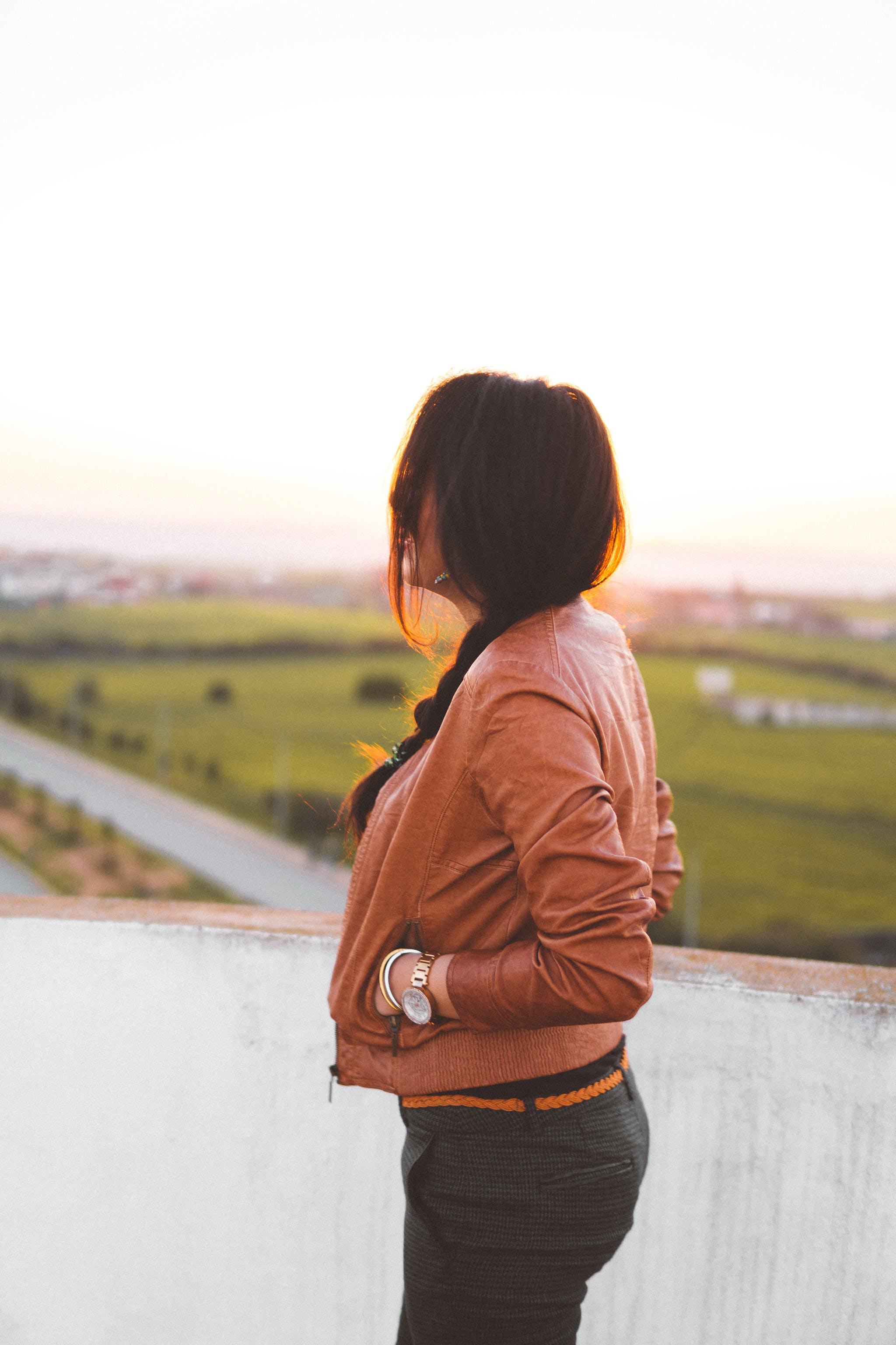 Side View of Woman Wearing Brown Leather Jacket