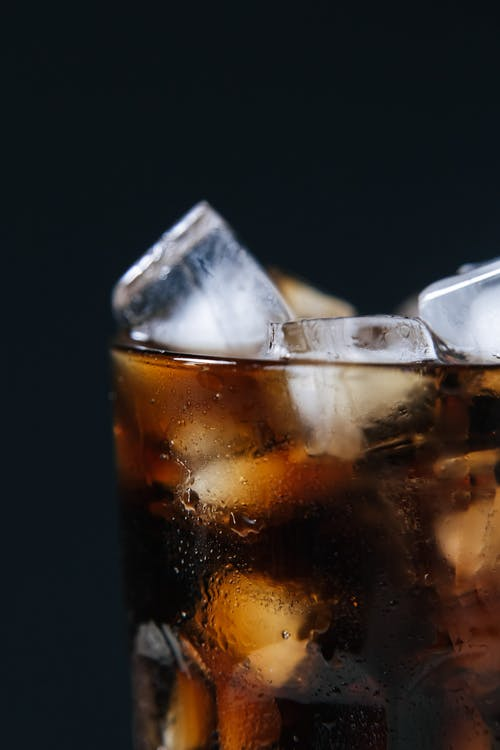 Close-Up Shot of a Soft Drink with Ice Cubes