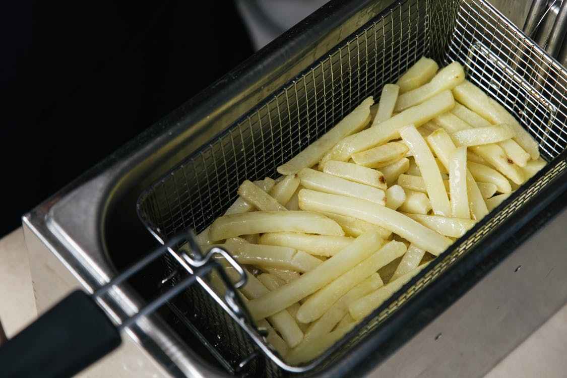 Close-Up Shot of Deep Frying French Fries