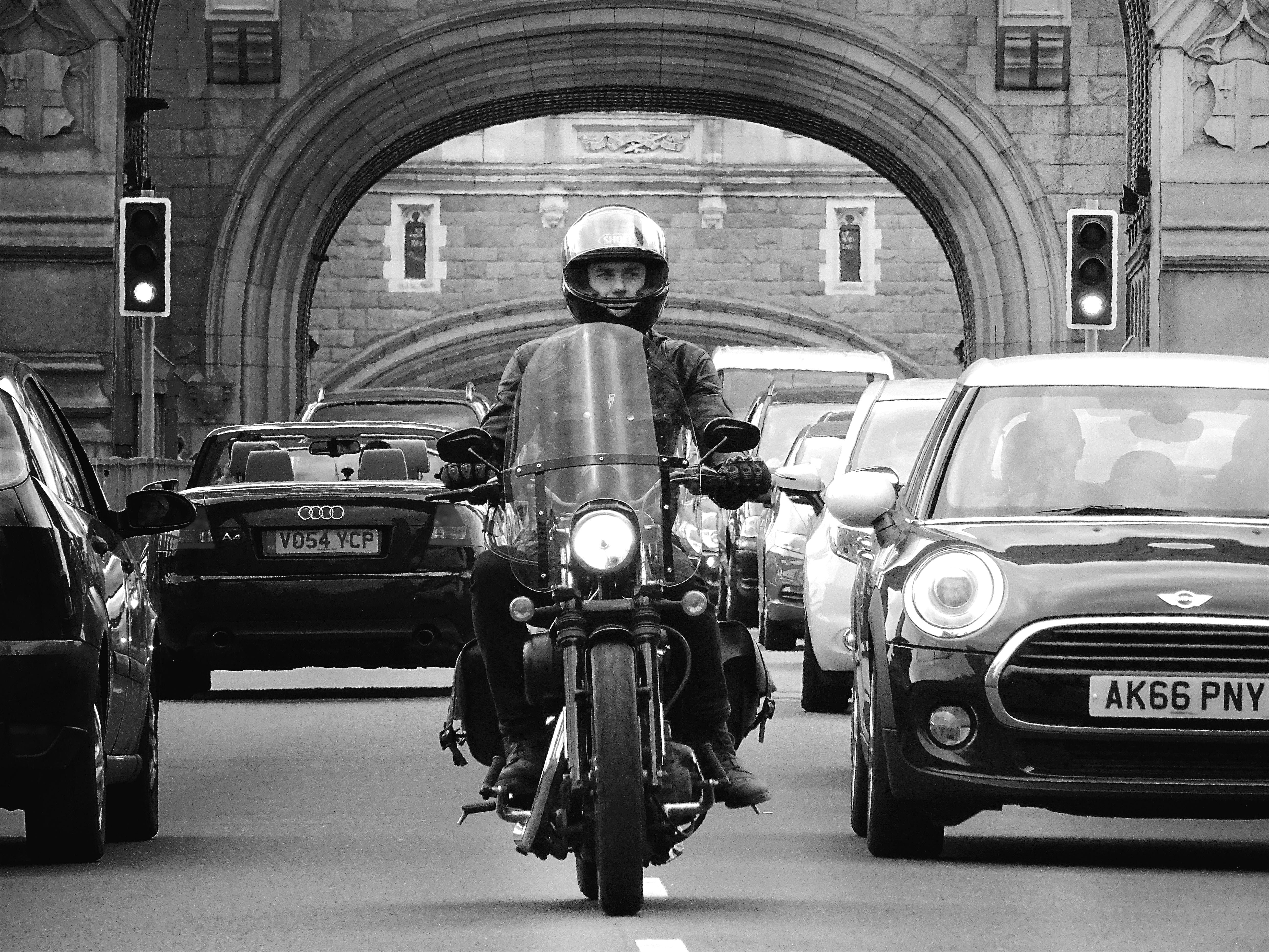 Man Riding Motorcycle Grayscale Photograhy