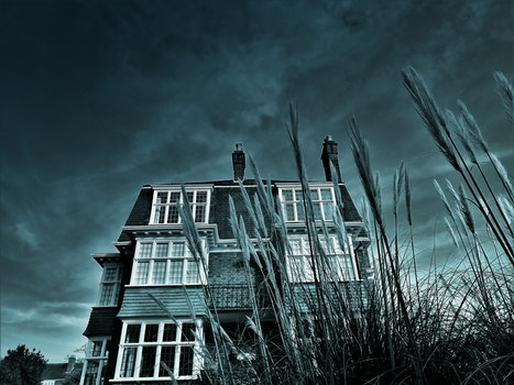Greyscale House Photo Under Clouds