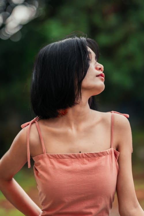 Woman Wearing Spaghetti Strap Top with Eyes Closed