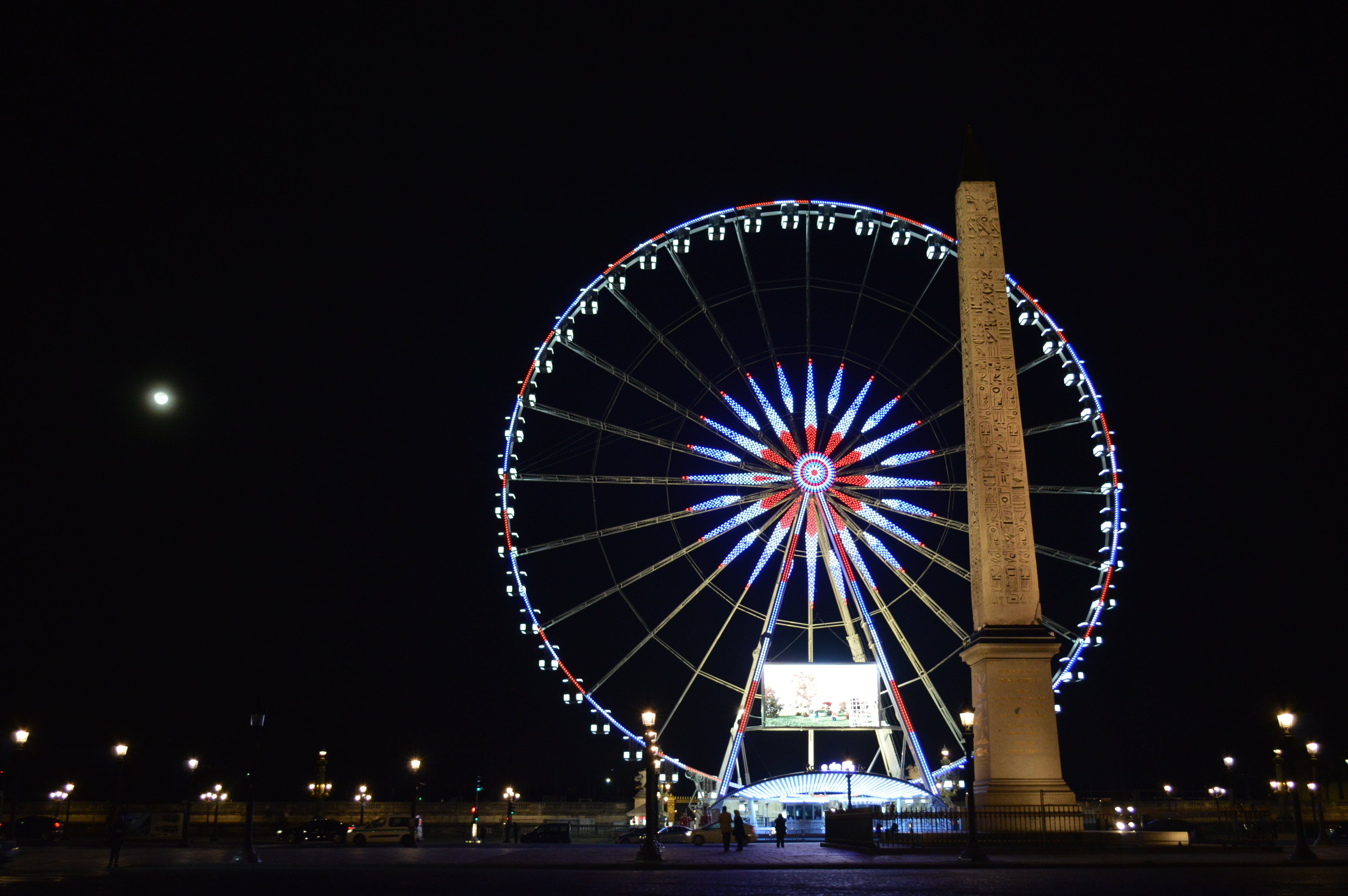 Photo of London Eye, London Near Brown Concrete Monument during Night Time