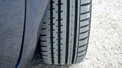 Black Car Tire on Gray Concrete Floor