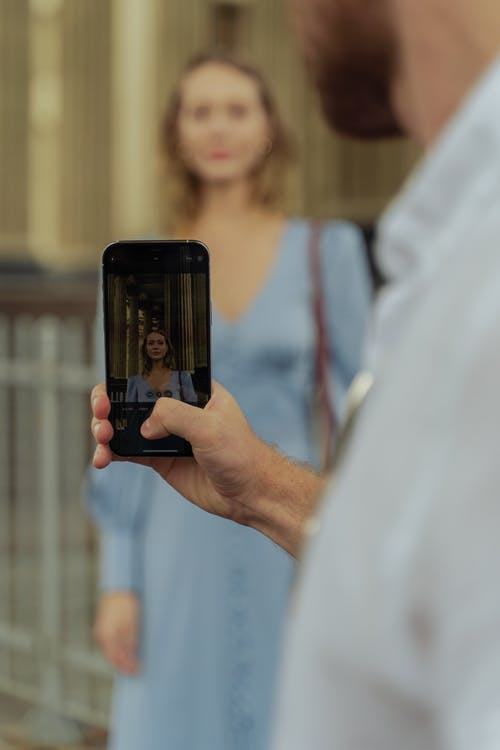 Close-Up Shot of a Person Taking Photo Using a Smartphone