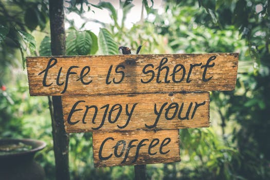 Shallow Photography of Life Is Short Enjoy Your Coffee Signage